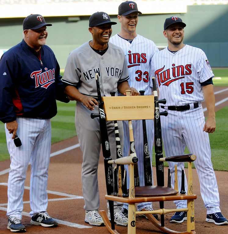 . Twins manager Ron Gardenhire and players Justin Morneau and Glen Perkins present Yankees reliever Mariano Rivera with a rocking chair made from broken bats before the game. Rivera is retiring after this season. (Pioneer Press: John Autey)