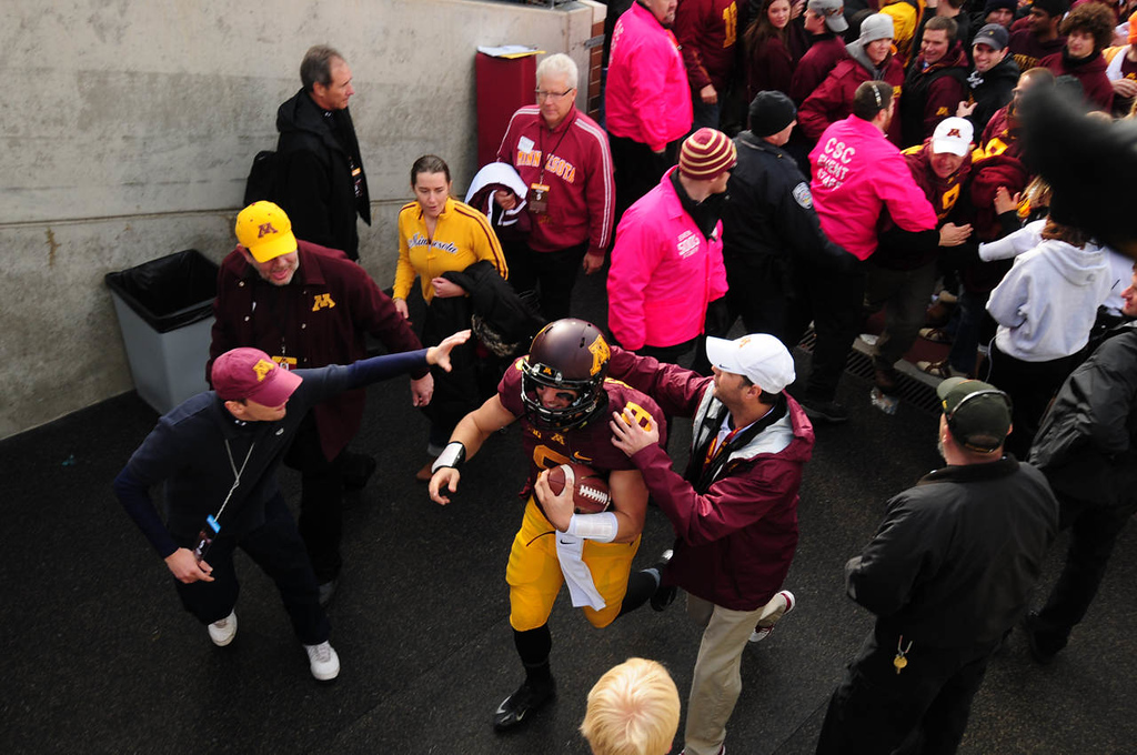 . Minnesota quarterback Philip Nelson is congratulated by cheering fans and Gophers staff as he leaves the field, as the University of Minnesota Golden Gophers beat the Nebraska Cornhuskers 34-23.  (Pioneer Press: Scott Takushi)