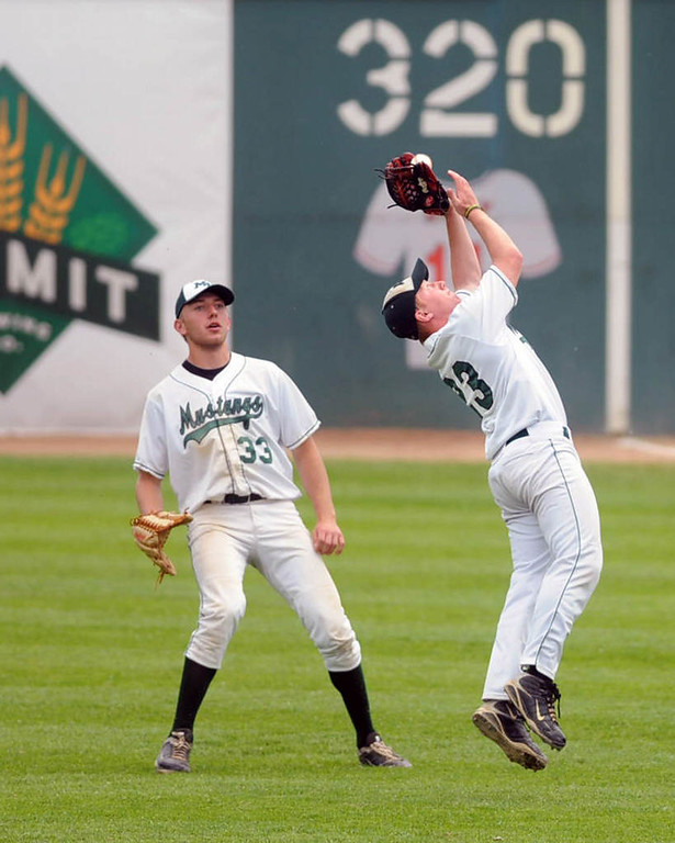 . Mounds View second baseman Nate Douvier, right, catches a fly ball in shallow right field hit by Coon Rapids\' Grant Farley during their Class 3A baseball semifinal game at Midway Stadium in St. Paul, Friday, June 14, 2013. Mounds View right fielder Max Knutson is at left. (Pioneer Press: Chris Polydoroff)