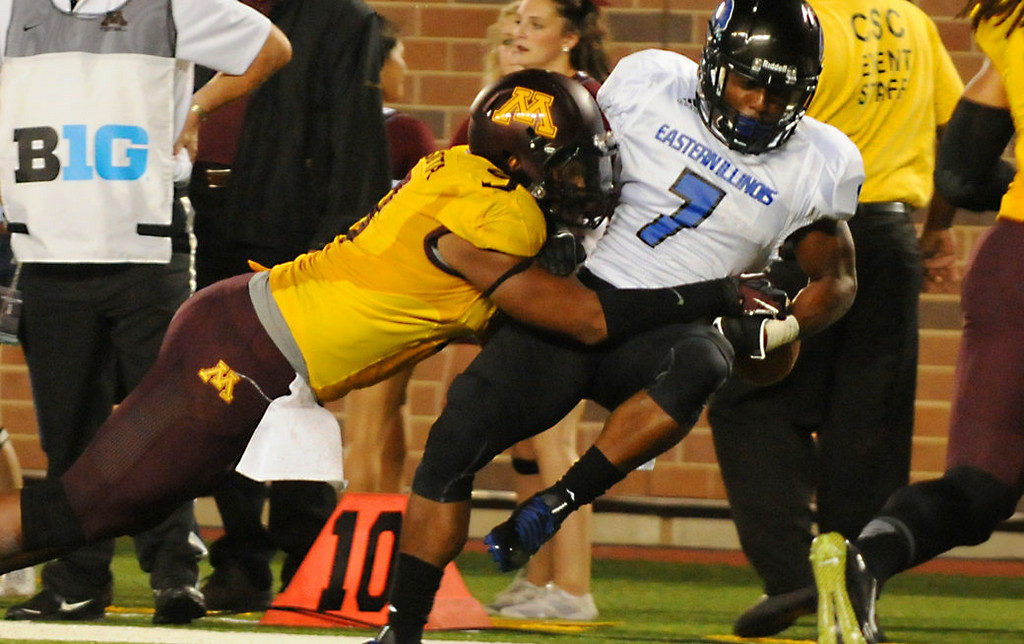. Minnesota defensive lineman Alex Keith strips the ball out of Eastern Illinois safety Bradley Dewberry\'s hands resulting in a Gophers fumble recovery in the fourth quarter. (Pioneer Press: John Autey)