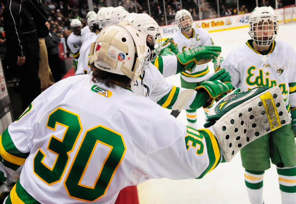 . Edina players, including goalie Andrew Rohkohl (30), celebrate one of their five second-period goals against Lakeville North.  (Pioneer Press: Scott Takushi)