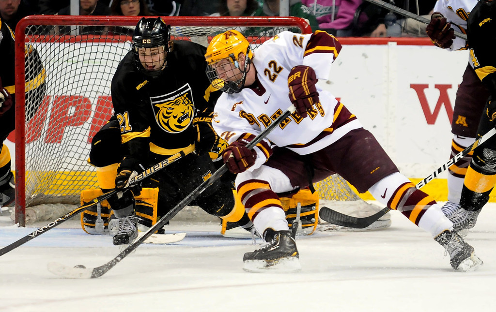 . Minnesota\'s Travis Boyd (22) gets into position to shoot as Colorado College\'s Jeff Collett (21) defends during the first period of  the WCHA Final Five at the Xcel Energy Center Arena on March 22, 2013. (Pioneer Press: Sherri LaRose-Chiglo)