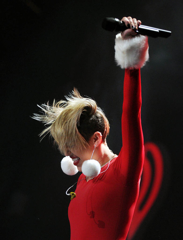 """. Miley Cyrus sings \""""Party in the USA\""""  at Xcel Energy Center in St. Paul, Tuesday, December 10, 2013. (Pioneer Press: Chris Polydoroff)"""