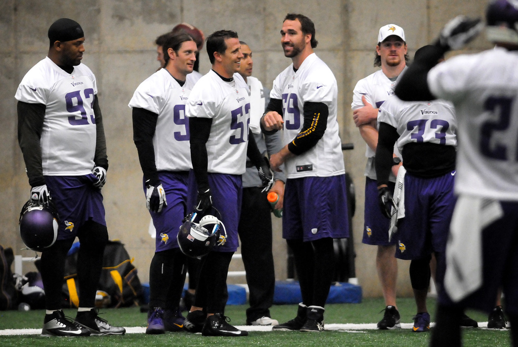 . Jared Allen, center, talks to Chad Greenway (52), Brian Robison (96) (behind Greenway), Kevin Williams (93) and other teammates during practice. (Pioneer Press: Jean Pieri)
