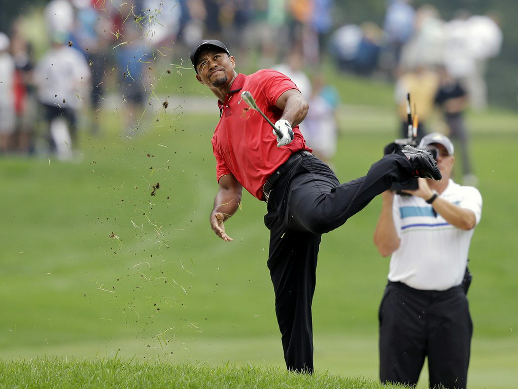 ". <p>4. (tie) TIGER WOODS </p><p>As Chris Berman might say: �Back, back, back, back, back ...� (10) </p><p><b><a href=""http://www.twincities.com/breakingnews/ci_26268314/woods-leaves-course-because-back-pain\"" target=\""_blank\""> LINK </a></b> </p><p>    (AP Photo/Mark Duncan)</p>"