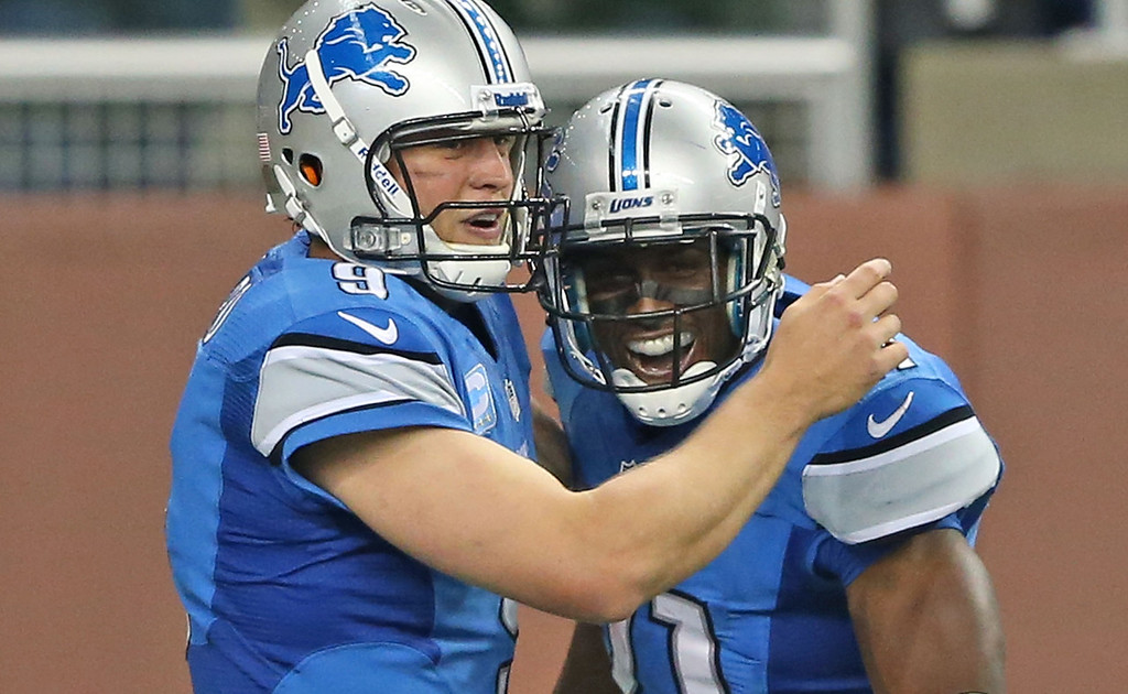 . Detroit\'s Reggie Bush, right, celebrates with quarterback Matthew Stafford after his 77-yard run for a third-quarter touchdown against the Vikings.  (Photo by Leon Halip/Getty Images)