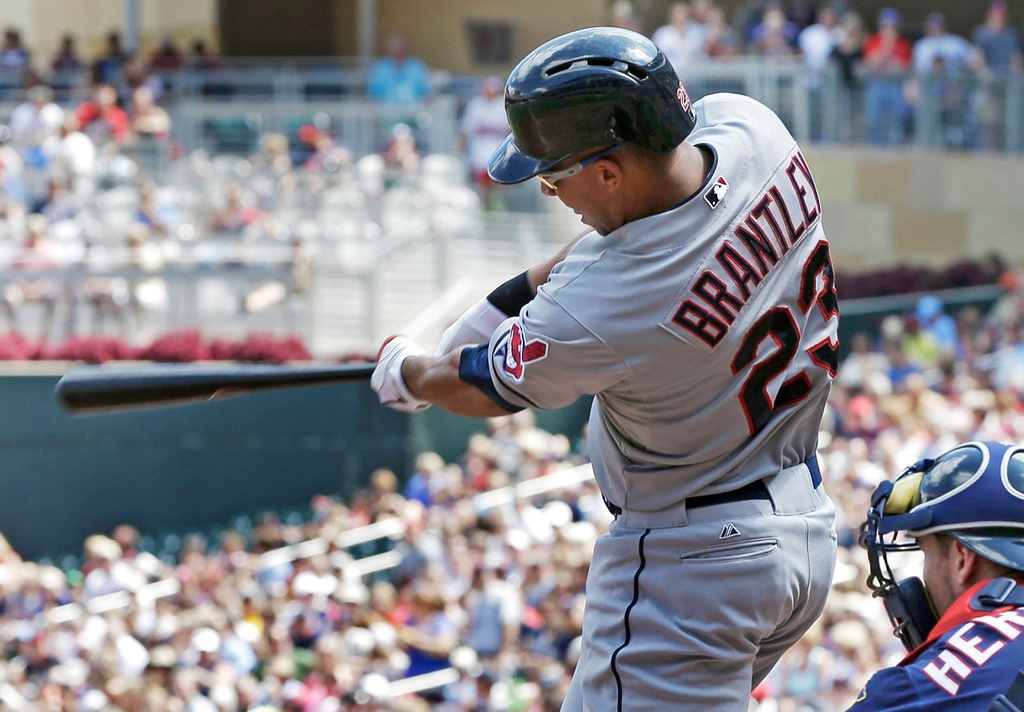 . Cleveland\'s Michael Brantley follows through on a bases loaded triple, knocking Twins starter Scott Diamond out of the game in the fifth inning. (AP Photo/Jim Mone)