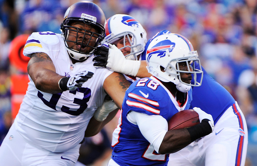 . Buffalo Bills running back C.J. Spiller (28) runs past Minnesota Vikings defensive tackle Kevin Williams (93) during the first half of an NFL preseason football game Friday, Aug. 16, 2013, in Orchard Park, N.Y.  (AP Photo/Gary Wiepert)