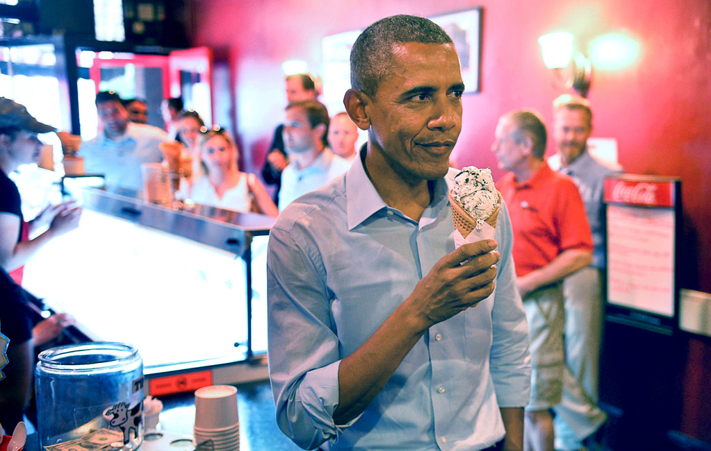 . President Barack Obama offers to buy ice cream for members of the media after he got a scoop of Black Hills Gold at Grand Ole Creamery on Grand Avenue in St. Paul on Thursday. (Pioneer Press: Ben Garvin)