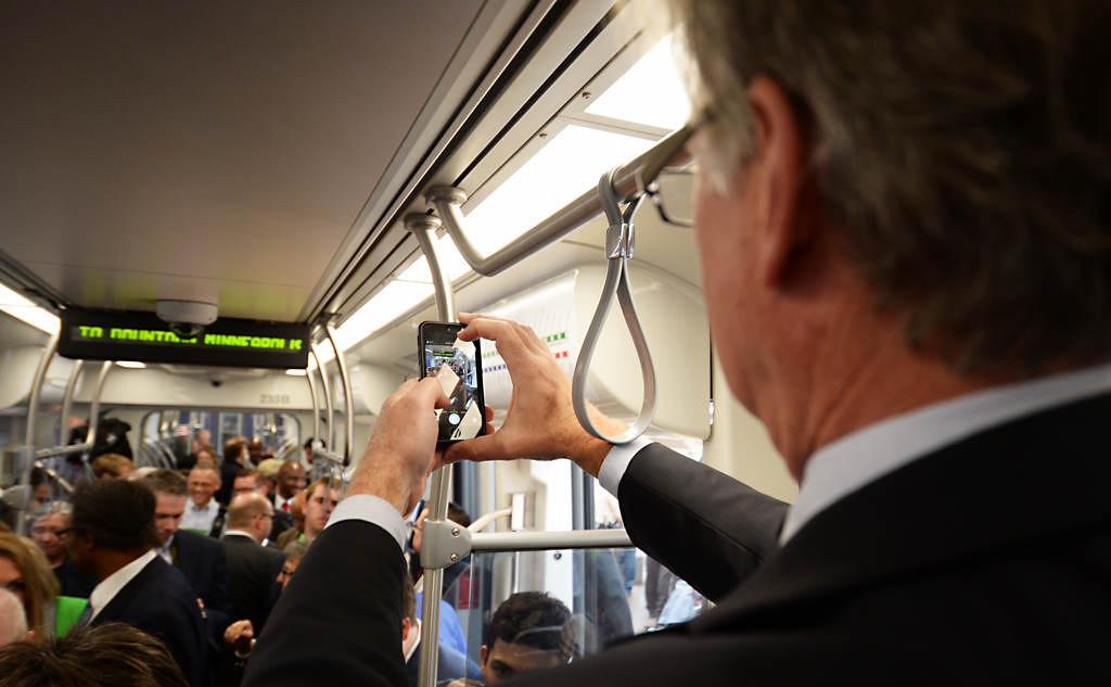 . St. Paul Mayor Chris Coleman takes a photo aboard the inaugural train. (Pioneer Press: John Autey)