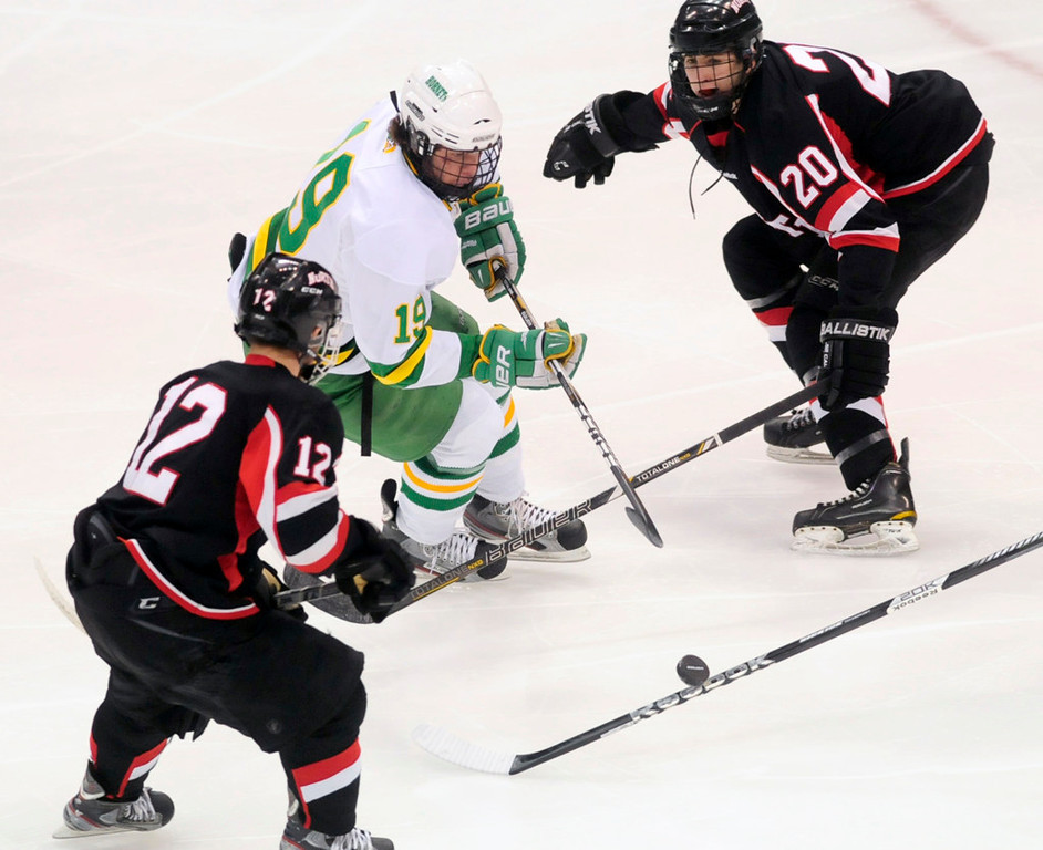 . Edina\'s  Bo Brauer cuts between Lakeville North\'s Conner Hyden, left and Dylan Malmquist in the first period.  (Pioneer Press: Scott Takushi)
