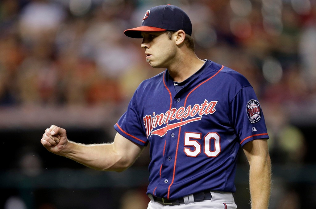 . Twins reliever Casey Fien pumps his fist after getting Cleveland\'s Mike Aviles to ground out to end the game, securing the Twins\' 5-1 win over the Indians at Progressive Field in Cleveland on Friday August 23, 2013. (AP Photo/Tony Dejak)