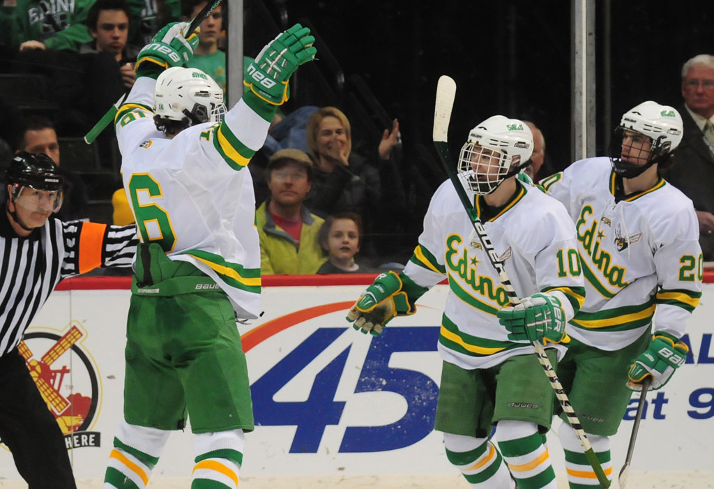 . Edina\'s  Connor Hurley, left, celebrates his hat trick in the second period with teammates Andy Jordahl, center, and Dylan Malmquist during the Hornets\' 9-3 win over Lakeville North in their Class AA quarterfinal game in the boys state hockey tournament at Xcel Energy Center in St. Paul on Thursday, March 7, 2013.  (Pioneer Press: Scott Takushi)