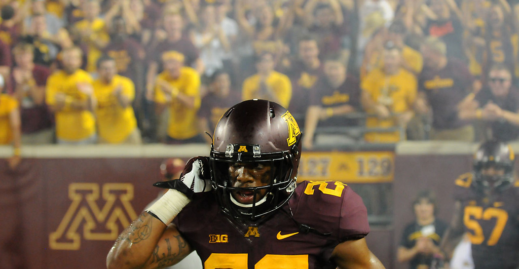 . Minnesota defensive back Briean Boddy-Calhoun unsnaps his helmet to the cheers of Gophers fans after returning a interception 89 yards for a touchdown in the fourth quarter. (Pioneer Press: John Autey)