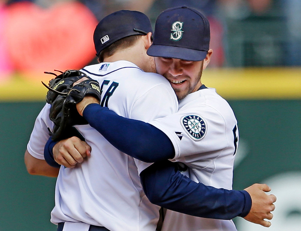 . Mariners infielders Nick Franklin, right, and Kyle Seager embrace after their team beat the Twins, 6-4, at Safeco Field in Seattle on Sunday July 28, 2013. Franklin was a one-man wrecking crew for the M\'s, going three for four with two home runs and four RBIs.   (AP Photo/Elaine Thompson)