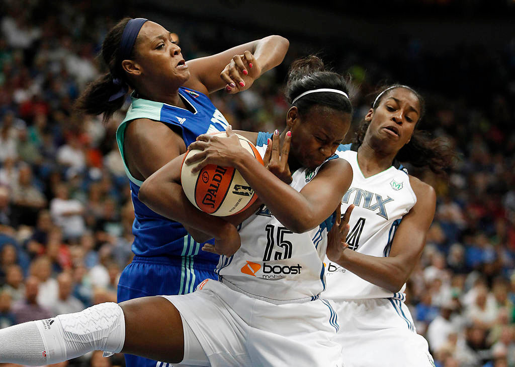 . New York Liberty forward Kara Braxton  fights for possession of the ball against Minnesota Lynx guard Ta\'Shauna Rodgers  in the first half of a WNBA basketball game, Sunday, Aug. 18, 2013, in Minneapolis. (AP Photo/Stacy Bengs)