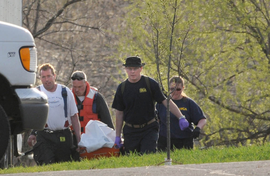 . Investigators carry a stretcher after a body was found in a small body of water in Chisago Township, off 261st Street and Kodiak Avenue, on Friday May 10, 2013. Chisago County Sheriff Rick Duncan told reporters about 8 p.m. Friday, that a female body retrieved from a small body of water in Chisago Township is thought to be that of Danielle Jelinek. Jelinek, 28, of Oakdale was reported missing on Dec. 9, 2012 after spending the night at the home of Aaron Schnagl, with whom her family members said she had an on-again, off-again relationship. Schnagl was jailed in Dec. 2012 on drug possession and probation violation charges stemming from a search of his Chisago Lake Township house after Jelinek was reported missing. He has not been charged in connection with her disappearance. (Pioneer Press: Jean Pieri)