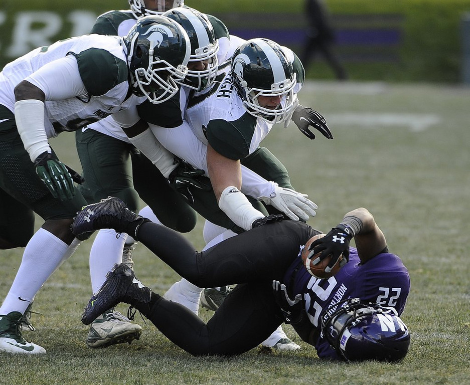 """. <p>4. NORTHWESTERN WILDCATS <p>Hoping to join a union, so they can get paid like all of the players in the SEC. (unranked) <p><b><a href=\'http://www.twincities.com/sports/ci_25009341/northwestern-football-players-seek-form-union\' target=\""""_blank\""""> HUH?</a></b> <p>   (David Banks/Getty Images)"""