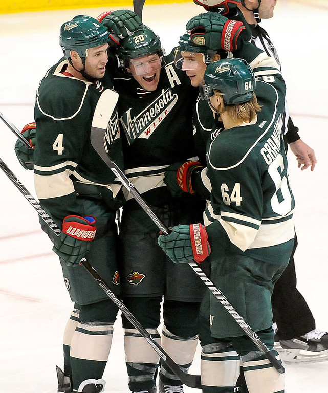 . Minnesota Wild  Ryan Suter, middle left, celebrates his hat track with teammates Clayton Stoner, left, Nino Niederreiter, middle right, and Mikael Granlund, right, during the third period.(Pioneer Press: Sherri LaRose-Chiglo)