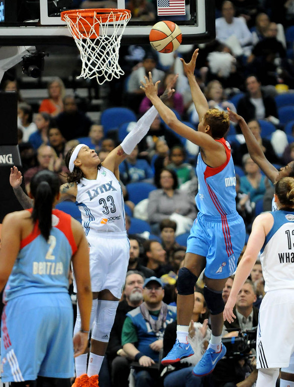 . Minnesota\'s Seimone Augustus blocks a shot by Atlanta\'s Angel McCoughtry during the second quarter. (Pioneer Press: Sherri LaRose-Chiglo)
