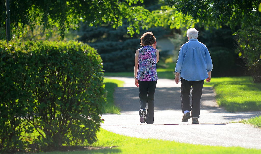 . Personal trainer Annie Elmer, left, walks with her client of two years, Toni Lambert of St. Paul Park, after a therapy session near her Cottage Grove home.  Elmer is optimistic that the coming changes in the nations health care system will benefit her care.  (Pioneer Press: John Autey)