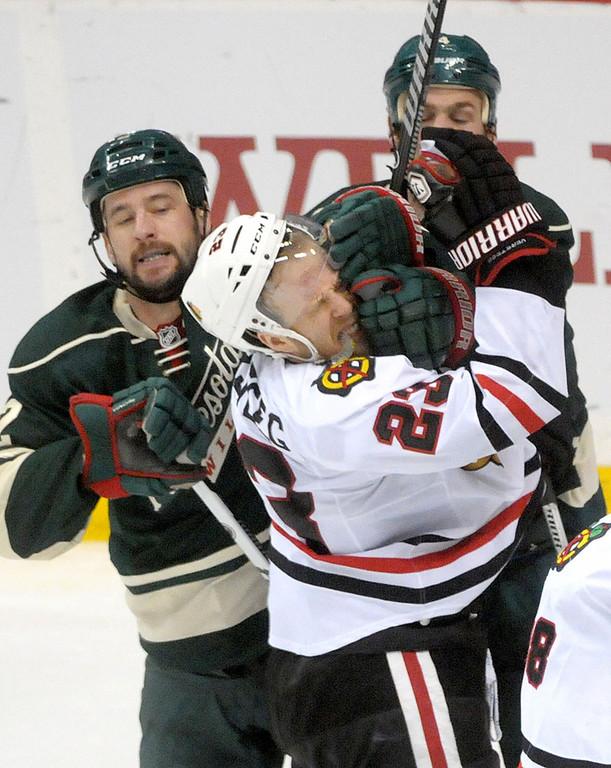 . Chicago Blackhawks Kris Versteeg is manhandled by Minnesota Wild Keith Ballard and Clayton Stoner during the overtime period.  (Pioneer Press: Sherri LaRose-Chiglo)