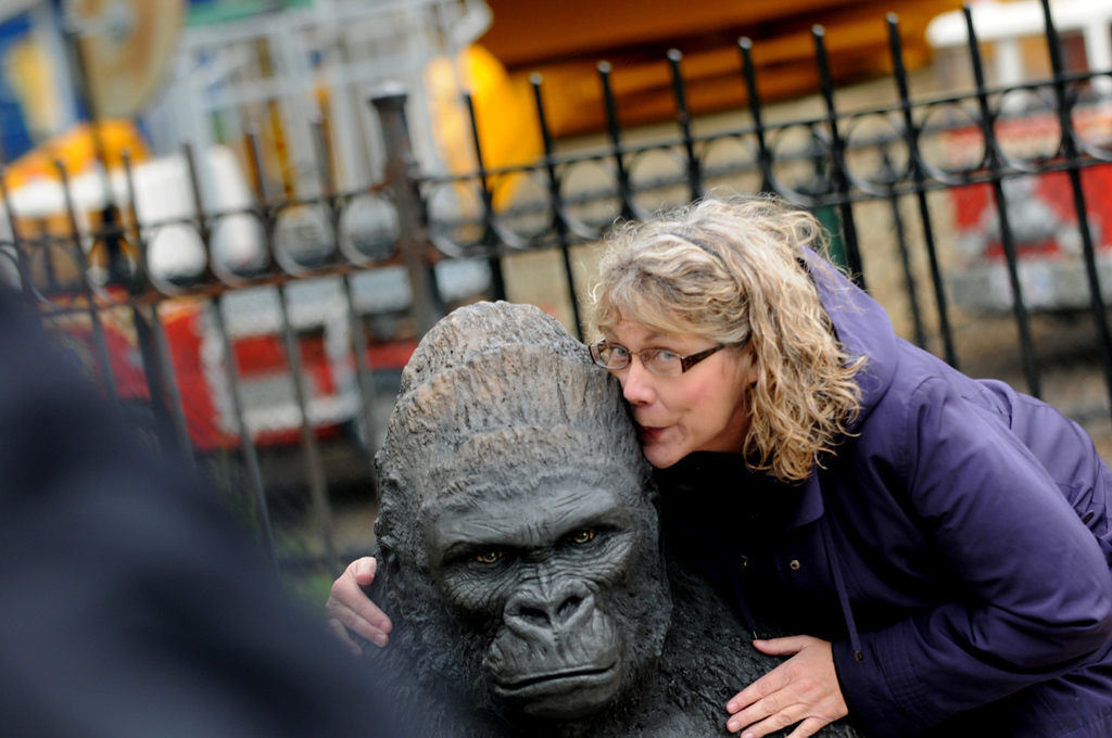 """. \""""I love monkeys!\"""" said Susan Peterson of Brooklyn Park, who hugs a statue outside the new Gorilla Forest at Como Park Zoo and Conservatory.  (Pioneer Press: Jean Pieri)"""