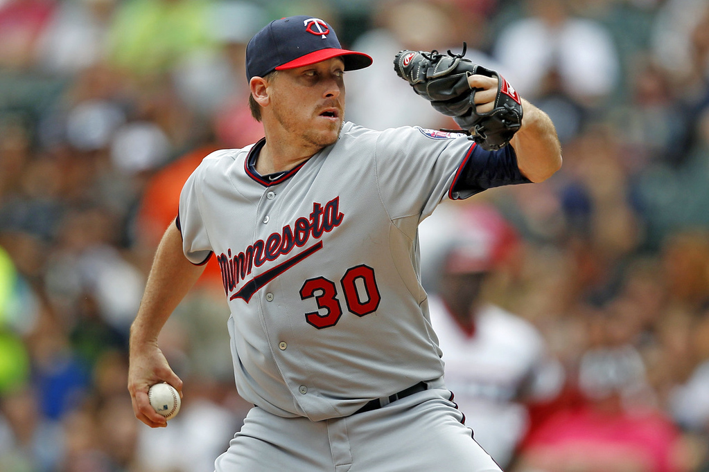 . Twins starter pitcher Kevin Correia delivers against the White Sox during the first inning. Correia threw seven innings of shutout ball, giving up five hits,  walking one and striking out seven batters.  (AP Photo/Andrew A. Nelles)