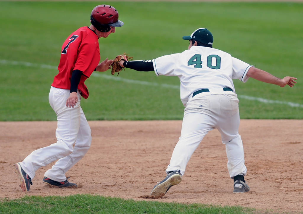 . Mounds View first baseman Keith Kubitschek, right,  tags out Coon Rapids\' Jace Hegg on a rundown and pickoff in the sixth inning. (Pioneer Press: Chris Polydoroff)