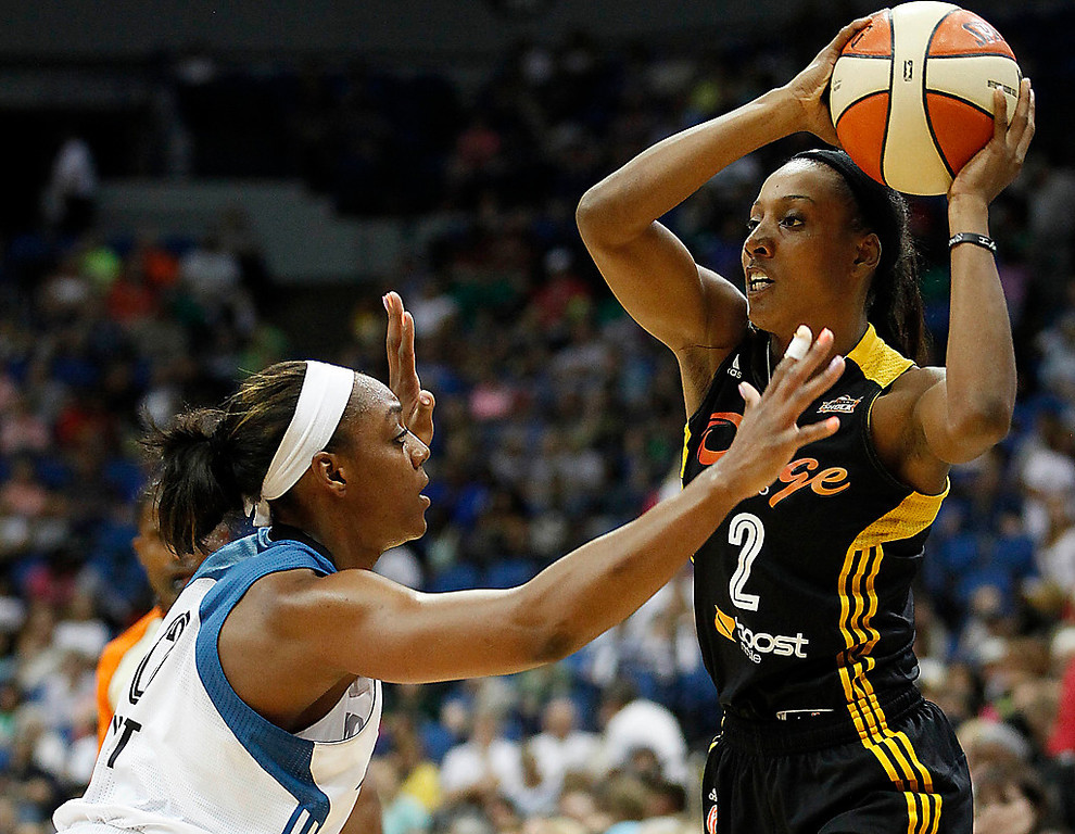 . Tulsa Shock guard Candice Wiggins (2) looks to pass against Minnesota Lynx guard Monica Wright, left, in the first half of Friday, Aug. 16, 2013, at Target Center. The Shock beat the Lynx 83-77, extending Minnesota\'s losing streak to three games. (AP Photo/Stacy Bengs)