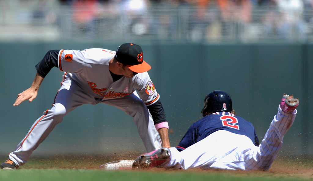 . Orioles shortstop J.J. Hardy tags Twins base runner Brian Dozier, who was out trying to to steal second base during the first inning. (Photo by Hannah Foslien/Getty Images)