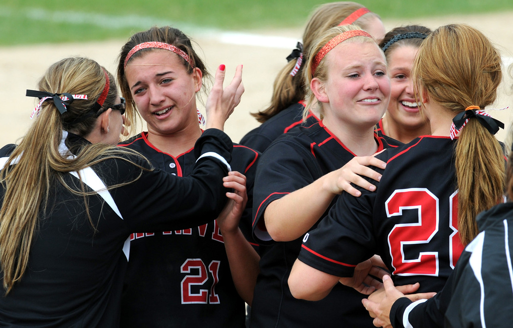 . Elk River teammates celebrate their 4-3 win over Prior Lake to win the Minnesota State High School League Class AAA softball championship at Caswell Park in North Mankato on Friday, June 7, 2013. (Pioneer Press: Jean Pieri)