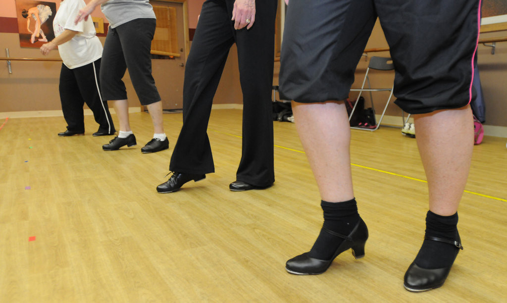 """. Students tap to \""""It\'s a Beautiful Day\"""" by Michael Buble as Nancy Raddatz leads her Wednesday night Adult Jazz-Tap class. (Pioneer Press: Ginger Pinson)"""