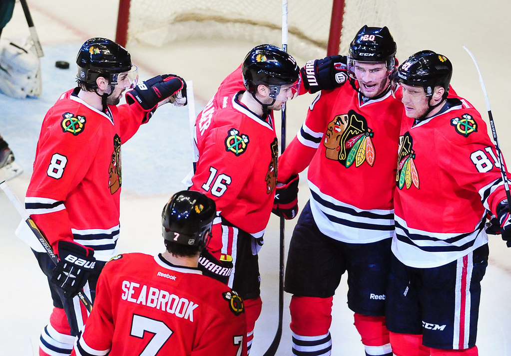 . Chicago players gather around Chicago right wing Marian Hossa, right, after he scored in the second period. (Pioneer Press: Ben Garvin)