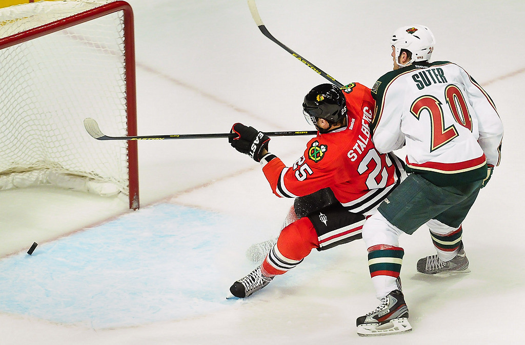 . Chicago Blackhawks left wing Viktor Stalberg prevents Minnesota Wild defenseman Ryan Suter from stopping an empty-net goal. (Pioneer Press: Ben Garvin)