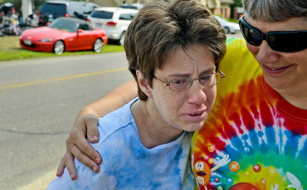 """. \""""I don\'t think it was fair that he got shot,\"""" said Tracey of Vadnais Heights. \""""It\'s just so sad.\""""  Tracey and a group of others from Merrick Inc. left work early to come show their respect for officer Patrick. (Pioneer Press: Ben Garvin)"""