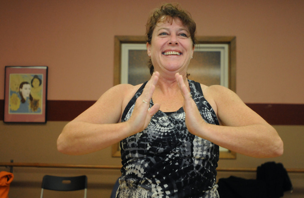 """. Mary Peterson works out to \""""Carly\'s Song\"""" by Enigma as she pulls her elbows back in the modern lyrical portion of her Wednesday night dance class. (Pioneer Press: Ginger Pinson)"""