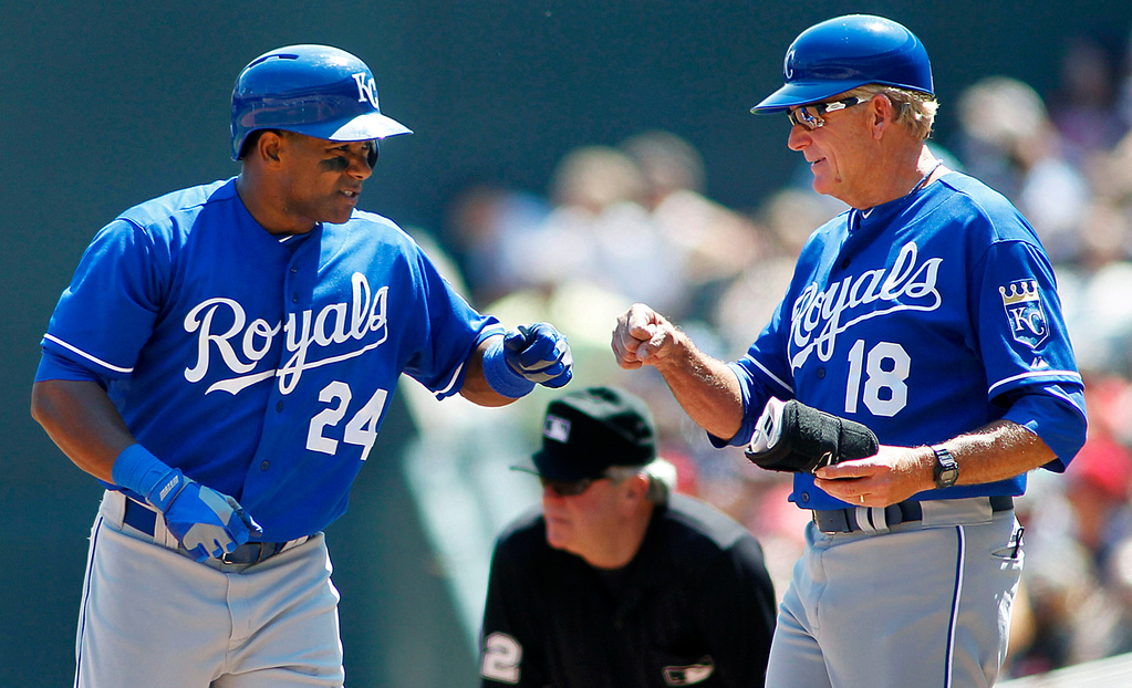 . Kansas City\'s Miguel Tejada is congratulated by Royals first base coach Rusty Kuntz after a single off Twins startrer Scott Diamond in the fourth inning. (AP Photo/Andy Clayton-King)
