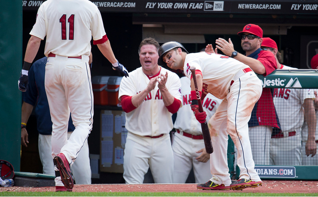 . Cleveland\'s Drew Stubbs, left, is greeted by happy teammates Jason Giambi, center and Nick Swisher after hitting a solo home run to break a 1-1 tie during the eighth inning against the Twins. (Photo by Jason Miller/Getty Images)