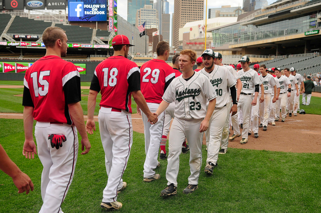 . Rocori players shake hands with Mounds View players, including Nate Douvier (23) and Keith Kubitschek (40), after the Mustangs beat the Spartans.  (Pioneer Press: Scott Takushi)