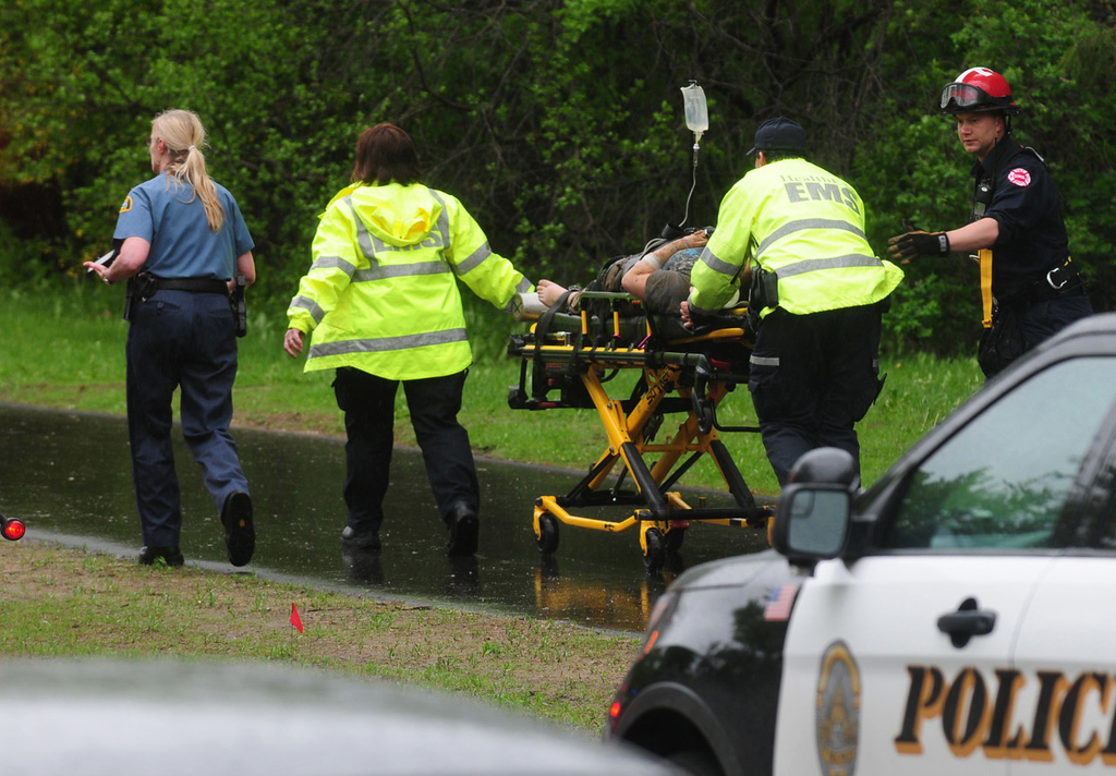. Emergency medical workers rush one of the injured to a waiting ambulance at Lilydale Regional Park. (Pioneer Press: Scott Takushi)