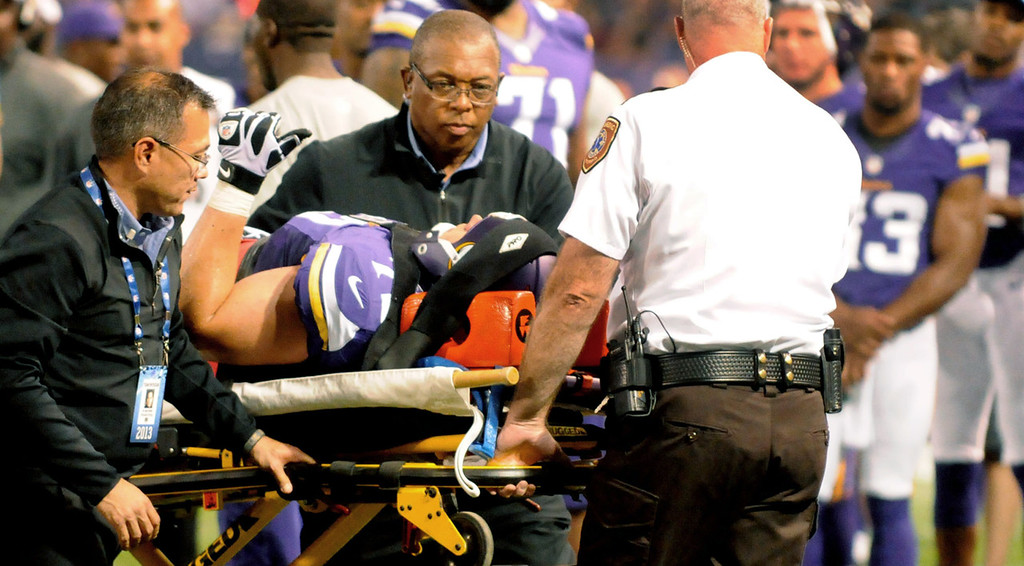 . Vikings guard Seth Olsen gives the thumbs up after an injury while being taken off the field after suffering a neck injury during the second quarter as teammates watch him leave the field during their game against the Titans.  (Pioneer Press: Sherri LaRose-Chiglo)