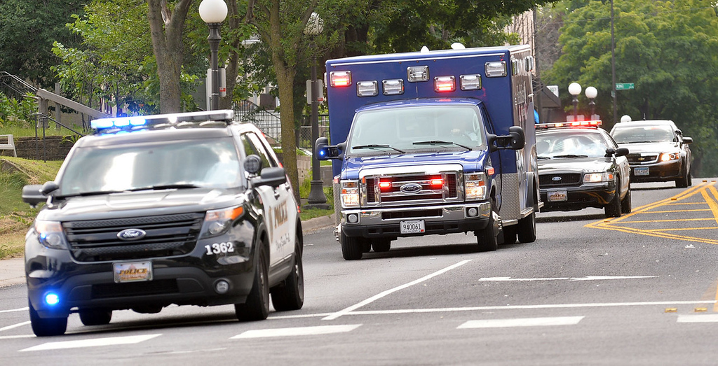 . Moments after  Mendota Heights Police Officer Scott Patrick was shot and killed during a traffic stop, the ambulance, escorted by multiple police vehicles, was speeding north on Smith Avenue in St. Paul on Wednesday. Police confirmed the officer was shot at Dodd Road and Smith Avenue in West St. Paul.  (Pioneer Press: Ben Garvin)