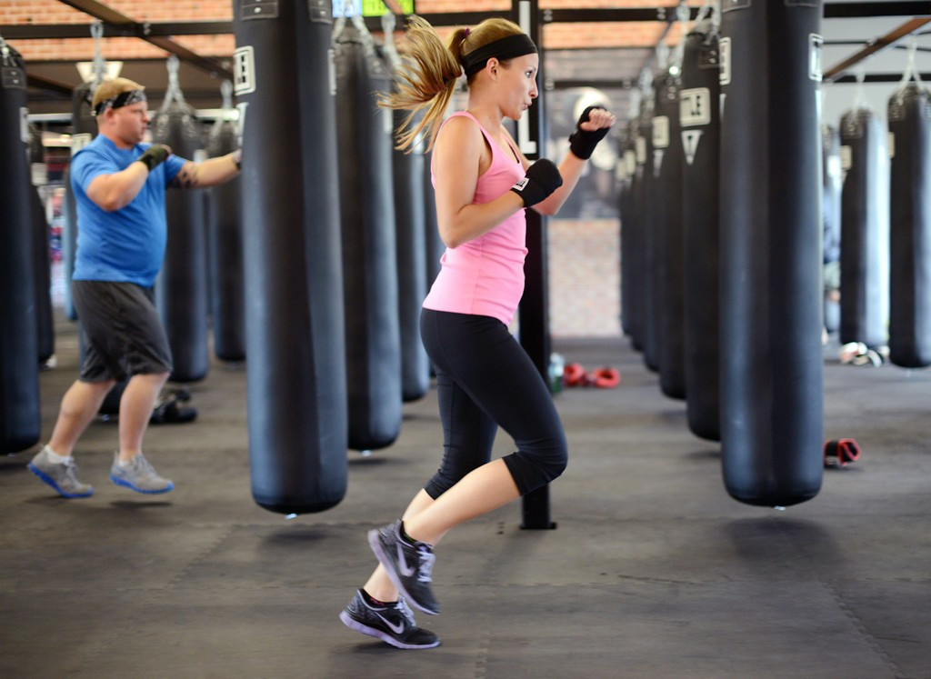 . Lindsay Spadino works out near the heavy bags during the 15-minute warmup period.  (Pioneer Press: Chris Polydoroff)