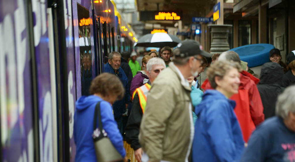 . Passengers exit the first Green Line train to arrive at Union Station during the Metro Transit Green Line Grand Opening in St. Paul. (Pioneer Press: John Autey)
