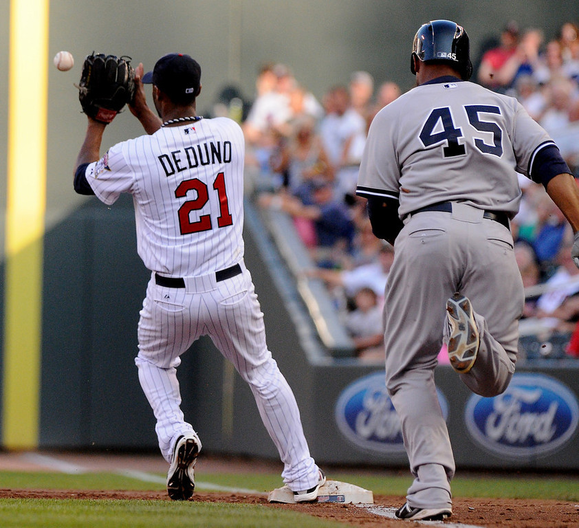 . Samuel Deduno finishes the putout of New York\'s Zoilo Almonte during the second inning. (Pioneer Press: John Autey)