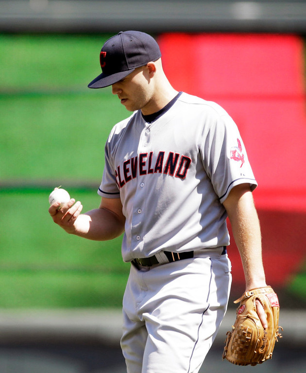 . Cleveland starter Justin Masterson  reacts after a double by Minnesota\'s Brian Dozier broke up Masterson\'s no-hit bid in the seventh inning. (AP Photo/Jim Mone)