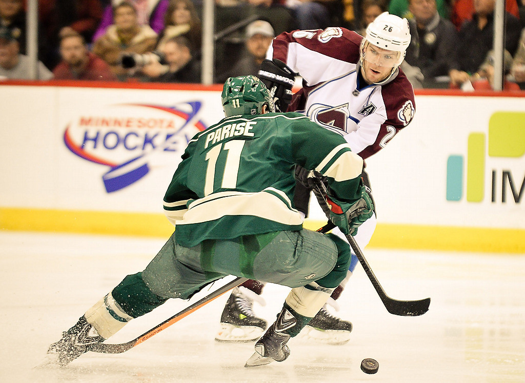 . Minnesota Wild left wing Zach Parise and Colorado Avalanche center Paul Stastny go after the puck during the third period. (Pioneer Press: Ben Garvin)