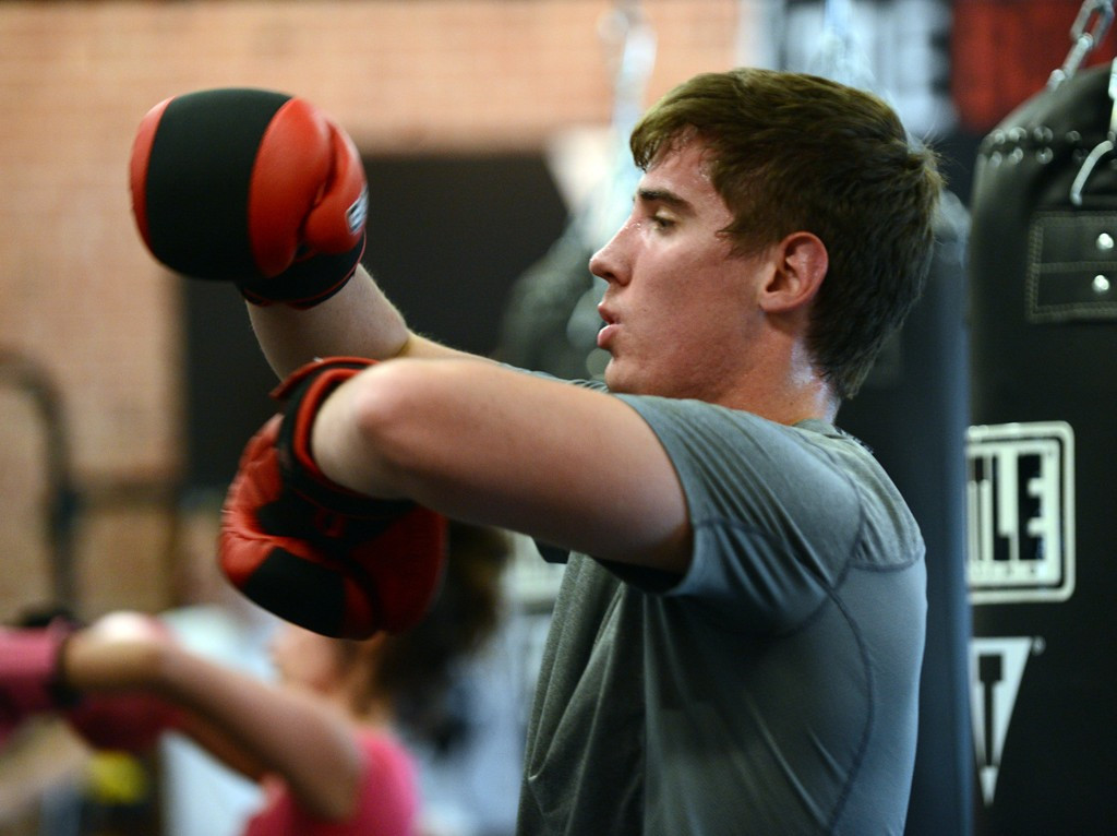 . Woodbury resident Nicholas Grizzell works out during a class.  Both his parents also participate in classes. (Pioneer Press: Chris Polydoroff)