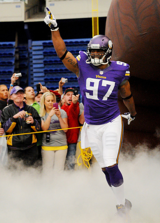 . Minnesota Vikings defensive lineman Everson Griffen runs onto the field modeling one of the new home uniforms. (Pioneer Press: John Autey)
